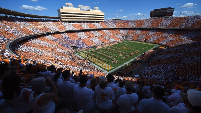 The University of Tennessee Pride of the Southland marching band performs a pregame show as fans checker Neyland Stadium orange and white for the Florida game on Saturday, Sept. 24, 2016.