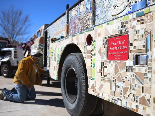 The Art in Uncommon Places mosaic firetruck at Firefighter's Memorial City Park honors a former fire chief and the city's firefighters in general.