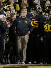 Iowa head football coach Kirk Ferentz waits with his team near the tunnel prior to kickoff against Minnesota on Saturday, Nov. 14, 2015, at Kinnick Stadium in Iowa City.
