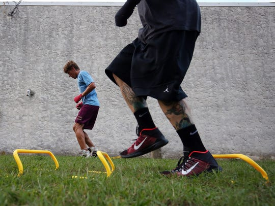 Students work on speed and agility training outside