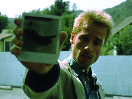 """Despite suffering from the inability to create new memories, Leonard (Guy Pearce) tries to track down the man responsible for his wife's murder in director Christopher Nolan's """"Memento."""""""