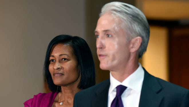Former Hillary Clinton aide Cheryl Mills, left, listens as House Select Committee on Benghazi Chairman Trey Gowdy, R-S.C., right, speaks to reporters on Capitol Hill in Washington, Sept. 3, 2015,