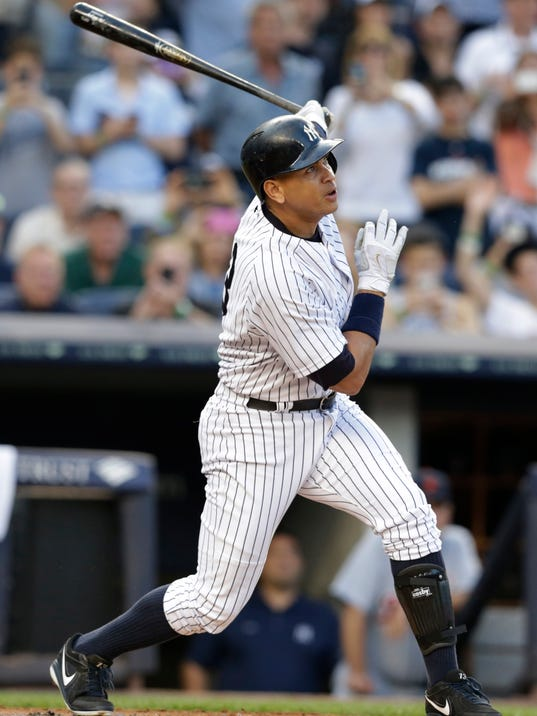 FILE - In this Friday, June 19, 2015, file photo, New York Yankees' Alex Rodriguez follows through on a home run for his 3,000th career hit, during the first inning of a baseball game against the Detroit Tigers, in New York. With Albert Pujols only 32 hits away from 3,000 in his career, the 2018 season will likely be the fourth straight season a player joins the prestigious club. (AP Photo/Frank Franklin II, File)