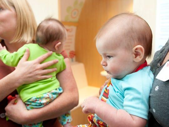 Five-month-old Eloise Dryden (right) of Burlington