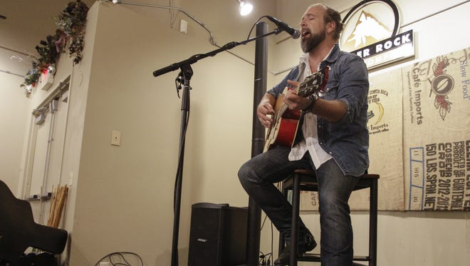 Rob Anthony performs in the gallery space at Copper Rock Coffee Company Thursday afternoon. It was one of the early performances on the first day of Mile of Music, a four-day music festival in downtown Appleton.
