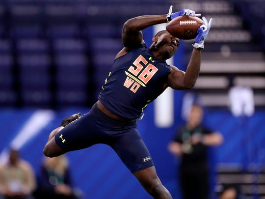 Florida State Seminoles wide receiver Bobo Wilson goes through pass catching workout drills during the 2017 NFL Combine at Lucas Oil Stadium.