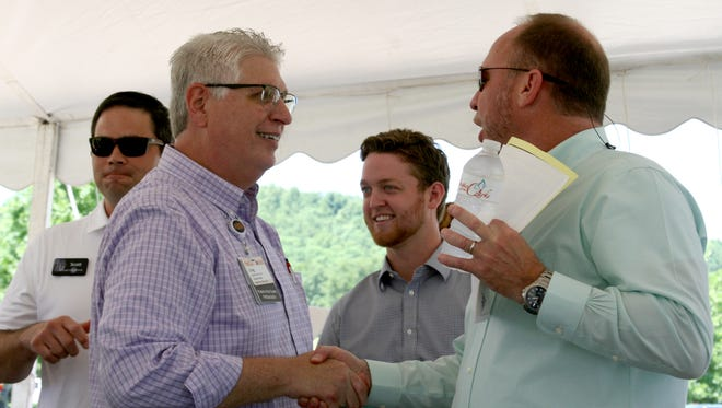 Hospice of the Ozarks Executive Director Greg Wood visits with attendees at Wednesday's ground breaking ceremony at the corner of Long Street and Burnett Drive.