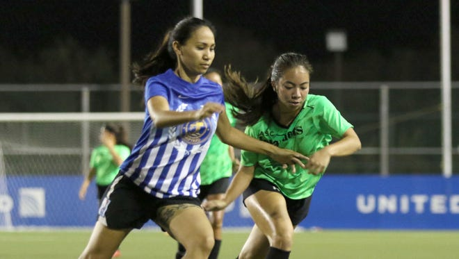 Guam Shipyard's Honoka Recella and ASC Trust Islanders' Thea Baker battle for possession of the ball in a quarterfinal match of the Bud Light Women's Soccer League Premier Division (W1) Sunday at the Guam Football Association National Training Center. Guam Shipyard won 13-1.