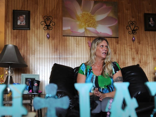 Kelly Jacobs talks in her Dover Township home about being denied a temporary protection from abuse order against her one-time boyfriend who she broke up with in November of 2015.
