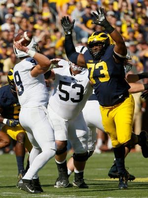 Michigan #73 Maurice Hurst jumps up to try and block the throw from Penn State quarterback #9 Trace McSorley during first half action.