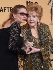 Debbie Reynolds, shown here with her late daughter