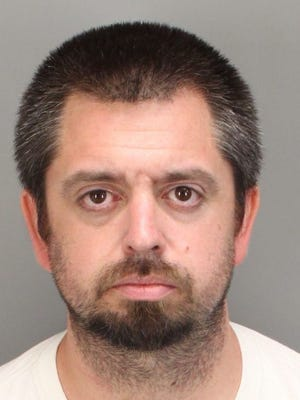 Victorville resident Ryan Carter is accused of using fake identification to gain access to Palm Springs' bank account.