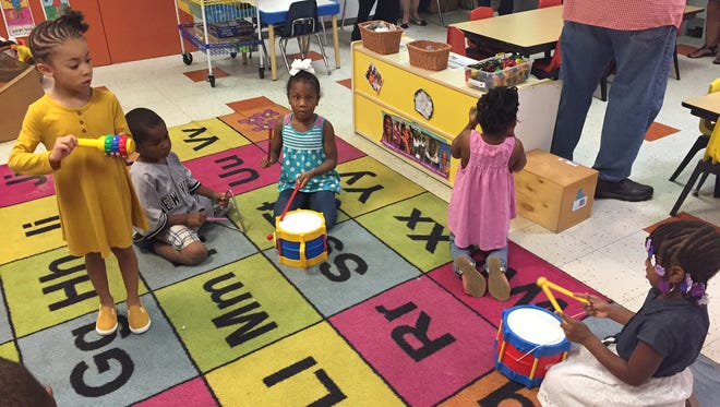 Children play music Friday morning at the Ministry of Caring's Child Care Center in Wilmington.  The organization recently received a $48,000 grant to help improve resilience in low-income children in the city.