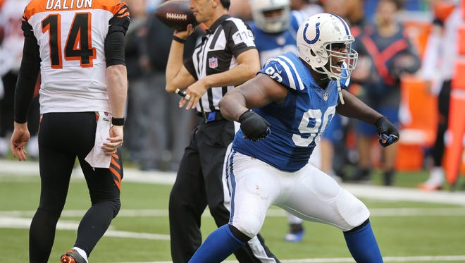 Colts defensive end Cory Redding screams in celebration after sacking Bengals quarterback Andy Dalton, Oct. 19, 2014.