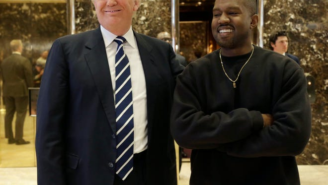 President-elect Donald Trump and Kanye West pose for a picture in the lobby of Trump Tower in New York, Tuesday, Dec. 13, 2016.