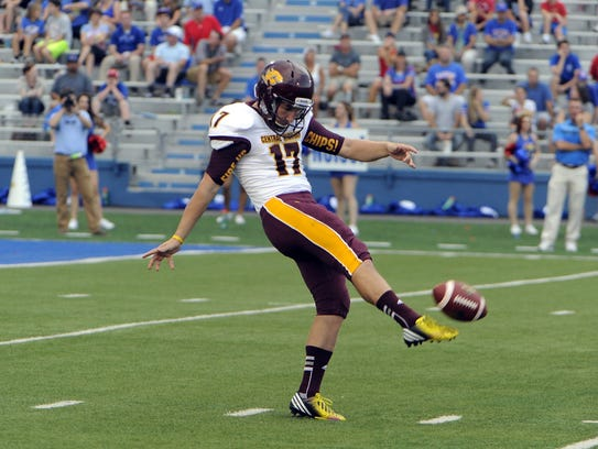 Central Michigan's Ron Coluzzi (17) punts against Kansas