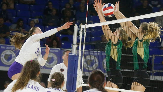 Portland's Katie Crutchfield hits the ball over the net during the TSSAA Class AA State Girls State Championship Volleyball game against Catholic on Thursday, Oct. 19, 2017, at MTSU.