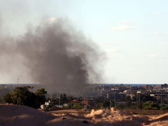 Smoke billows from buildings after the air force from