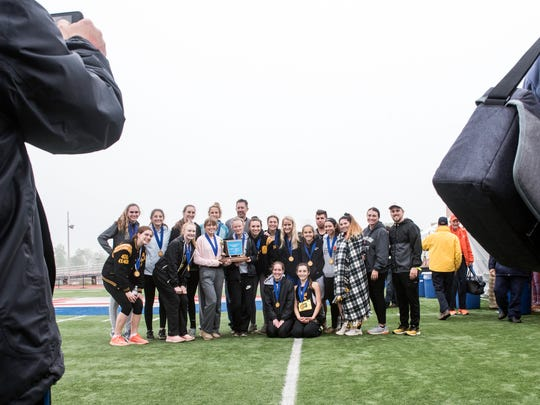 The Delone Catholic girls' team poses for a photo after winning the Class 2A team championship at the District III track and field championships held at Shipppensburg University, Saturday, May 19, 2018.