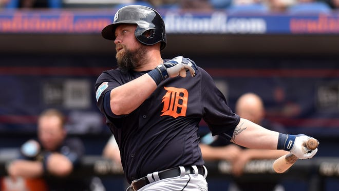 Mar 7, 2016; Port St. Lucie, FL, USA; Detroit Tigers first baseman Casey McGehee (31) connects for an RBI single during a spring training game against the New York Mets at Tradition Field.