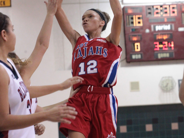 Indio High School's Jazmyne Santiel shoots a basket during their contest against La Quinta High School at La Quinta on Tuesday night.
