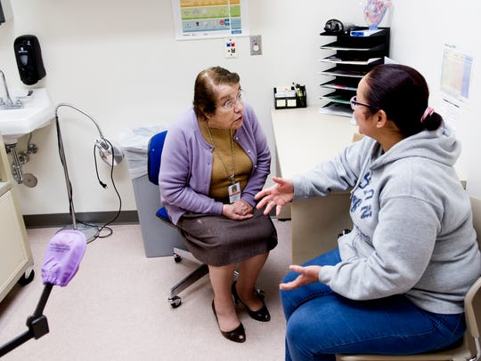 Blanca Simonian speaks with patient Maria Cristina