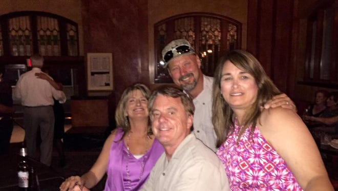 Steve Smelser, back, poses for a picture with friends in February. Smelser was found dead in April at his Las Cruces home. His death was ruled a suicide, but his family suspects foul play.