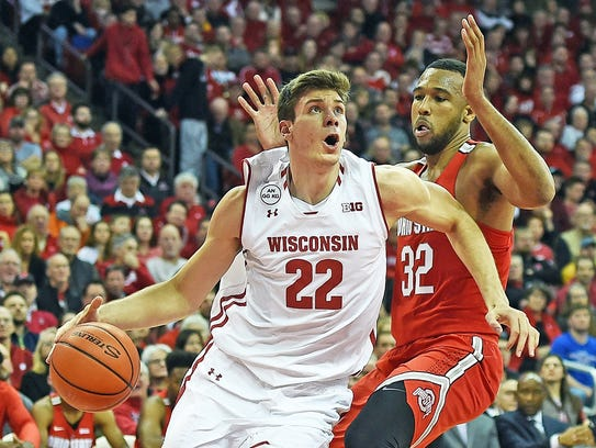 Ethan Happ of the Badgers drives to the basket against