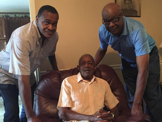 Charles Rucker, center, visits with his sons Dennis, left, and Charles.