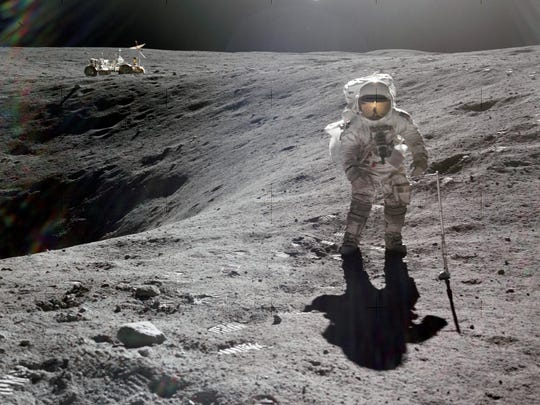 Charles Duke, the lunar module pilot for Apollo 16, collects lunar samples in 1972.