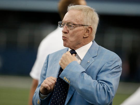 """FILE - In this Aug. 28, 2014, file photo, Dallas Cowboys owner Jerry Jones looks on before an NFL preseason football game against the Denver Broncos in Arlington, Texas. The usually optimistic Jerry Jones is using """"uphill climb"""" rather than """"Super Bowl"""" to describe the outlook of his Cowboys.  (AP Photo/Brandon Wade, File)"""