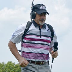 CBS commentator David Feherty navigates Plainfield Country Club during the final round.