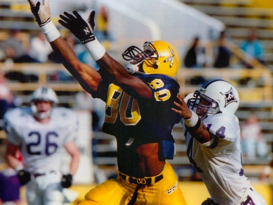 In this undated photo provided by the University of Tennessee Chattanooga athletic department, wide receiver Terrell Owens (80) plays in an NCAA college football game for the school. Owens will be giving his Hall of Fame induction speech at the University of Tennessee at Chattanooga on Saturday, Aug. 4, 2018, where he played college football, rather than appearing at the ceremony in Canton with his fellow honorees. (UTC Athletics via AP)