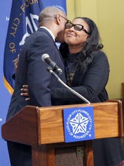 Cedric Alexander embraces Mayor Lovely Warren during the announcement.