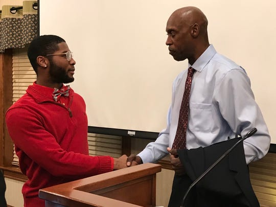 Former Olympic and world champ Butch Reynolds talks with Northmor all-star and two-time state track champion Meechie Johnson after Thursday's banquet celebrating the 40th anniversary of the News Journal Classic.