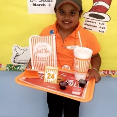South Texas girl, 7, dressed up as a Whataburger employee for career day
