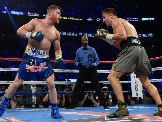 Canelo Alvarez, left, and Gennady Golovkin fought to