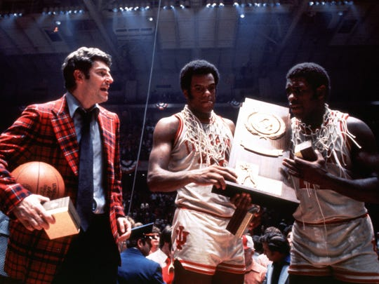 Bob Knight, Scott May (middle) and Quinn Buckner celebrate winning the 1976 national championship.