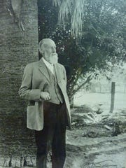 Welwood Murray in his palm-shaded garden.