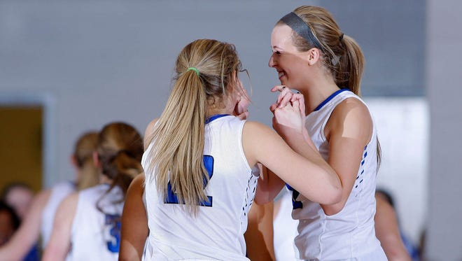 Bath's Emily Angell, right, and Jessica Stoskopf celebrate following their 49-47 win over Pewamo-Westphalia Thursday, Jan. 26, 2017, at Bath High School.