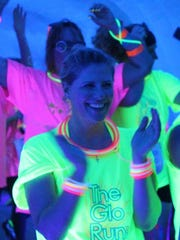 Get a team of friends and light up the night at The Glo Run.