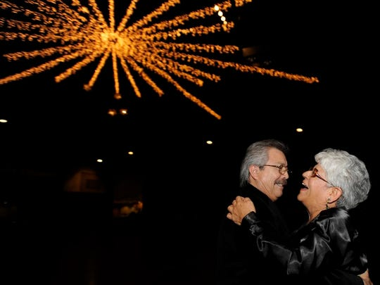 Published onlineRuben and Patricia DeLeon dance at the American G.I. Forum's New Year's Eve dance at the Visalia Convention Center.Photo taken on 12/31/08 in Visalia. Photo by Johanna Coyne1231_FEA_NYEve_7641Camera data: 12/31/08 at 9:23:27 PM, ISO 200, 1/40 @ f/2.8, WB=FLASH, 17mm, , FINE, frame 7641.