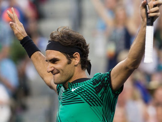 Roger Federer, of Switzerland his win against Rafael Nadal, of Spain, during their fourth round match on Stadium 1 during the 2017 BNP Paribas Open at Indian Wells Tennis Garden.