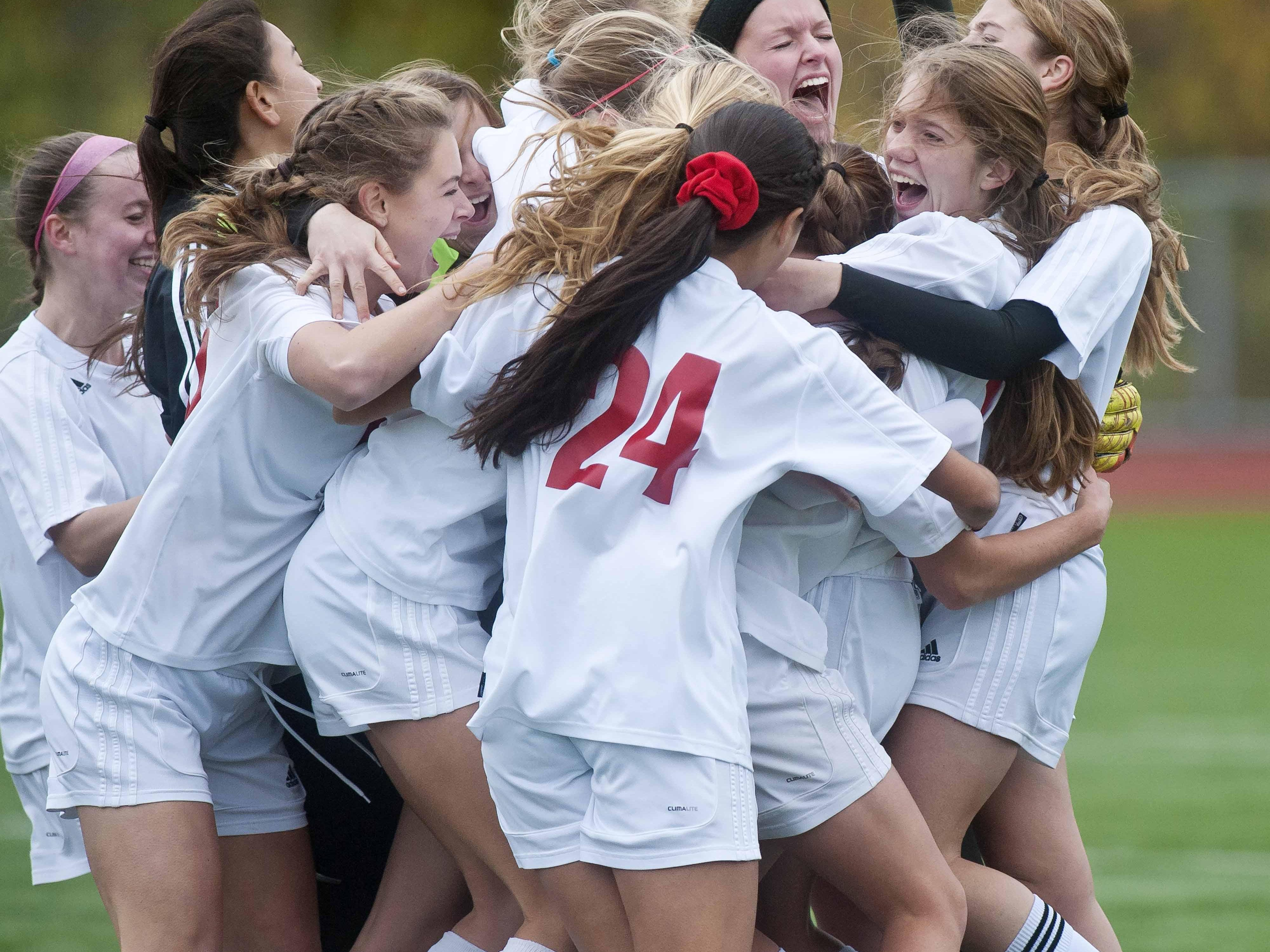 CVU's players celebrate their victory over Burlington during the Girls' Division 1 state championship in Burlington on Saturday, November 31, 2014.
