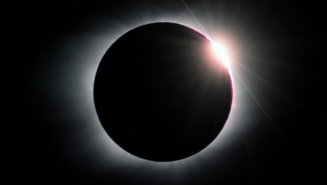 """The last glint of sunlight vanished behind the edge of the moon producing the """"diamond ring"""" effect during the  total solar eclipse of Feb. 26, 1998, as photographed by Johnny Horne from off the coast of Venezuela."""