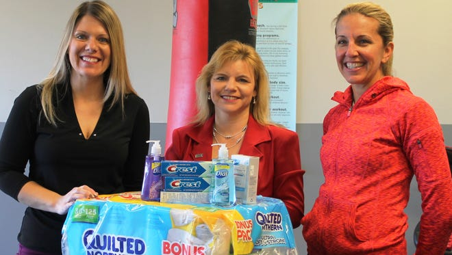 Caring from the Heart personal care product drive for Inter Parish Ministry participants are (from left) Michelle Hamilton from Park National Bank, Tamara Ackermann from First Finacial and Lisa Coors from Coors Core Fitness.