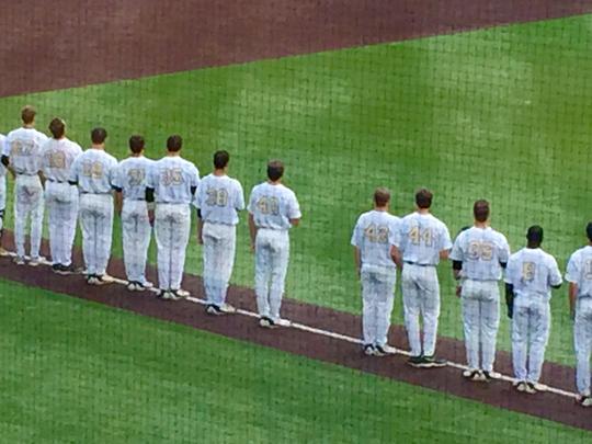 Vanderbilt baseball team leaves an open space in line during the nation anthem for Donny Everett.