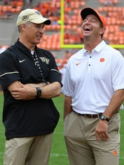 Wake Forest head coach Dave Clawson, left, talks with Clemson head coach Dabo Swinney during pre-game on Saturday, October 7, 2017 at Clemson's Memorial Stadium.