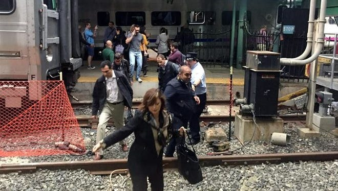 Passengers rush to safety after a NJ Transit train crashed into the platform at the Hoboken Terminal Sept. 29, 2016, in Hoboken, New Jersey.