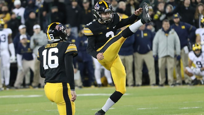 Iowa kicker Keith Duncan (3) gives the Hawkeyes the win over Michigan at Kinnick Stadium, 14-13, on Saturday.